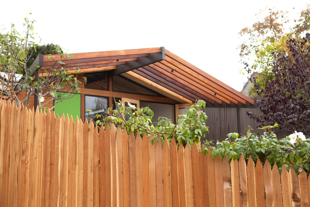 fence and wall with green door and overhang // Prospect Studio by Sky Lanigan for Medium Plenty