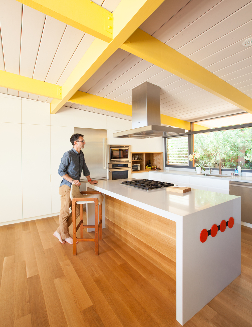 kitchen with bright yellow beams // Sunset House by Sky Lanigan for Medium Plenty
