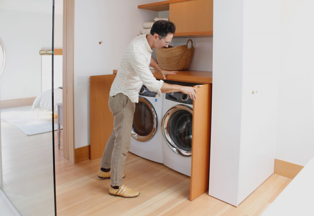 laundry with custom cabinet // Carriage House by Sky Lanigan for Medium Plenty
