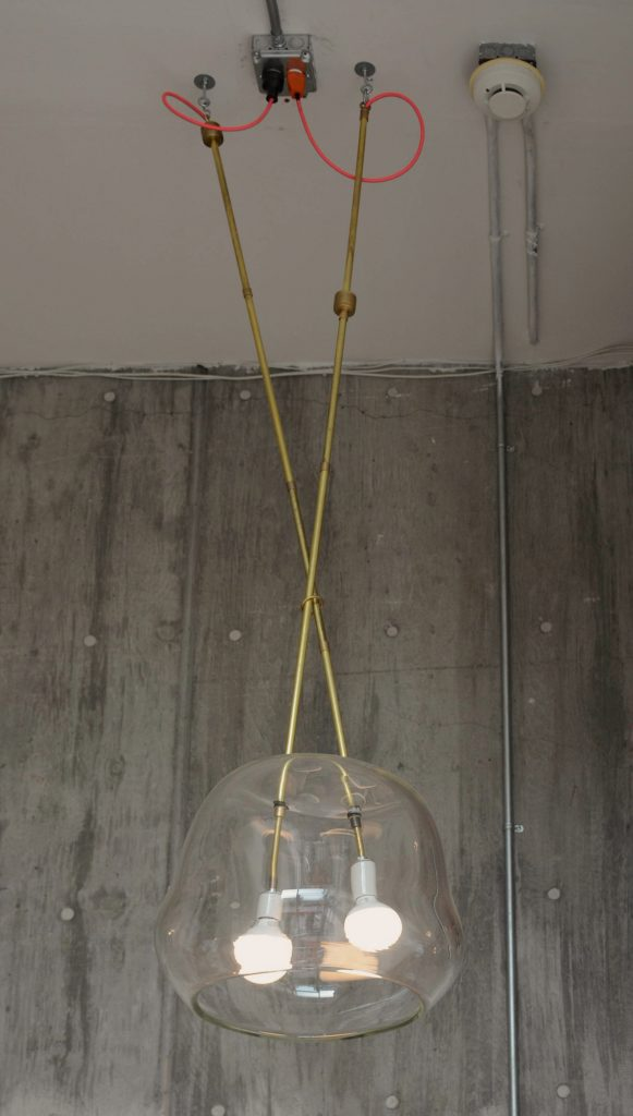 custom lighting fixture with two bulbs in one glass shade // Lighting by Sky Lanigan