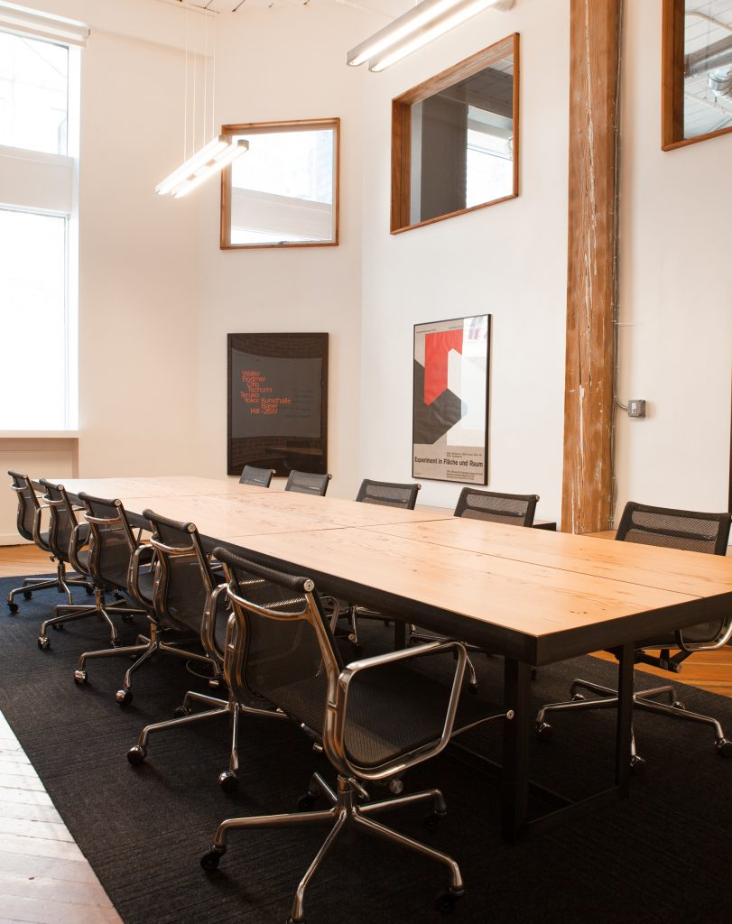 meeting table in front of large windows // Method Office by Sky Lanigan Studios for Medium Plenty