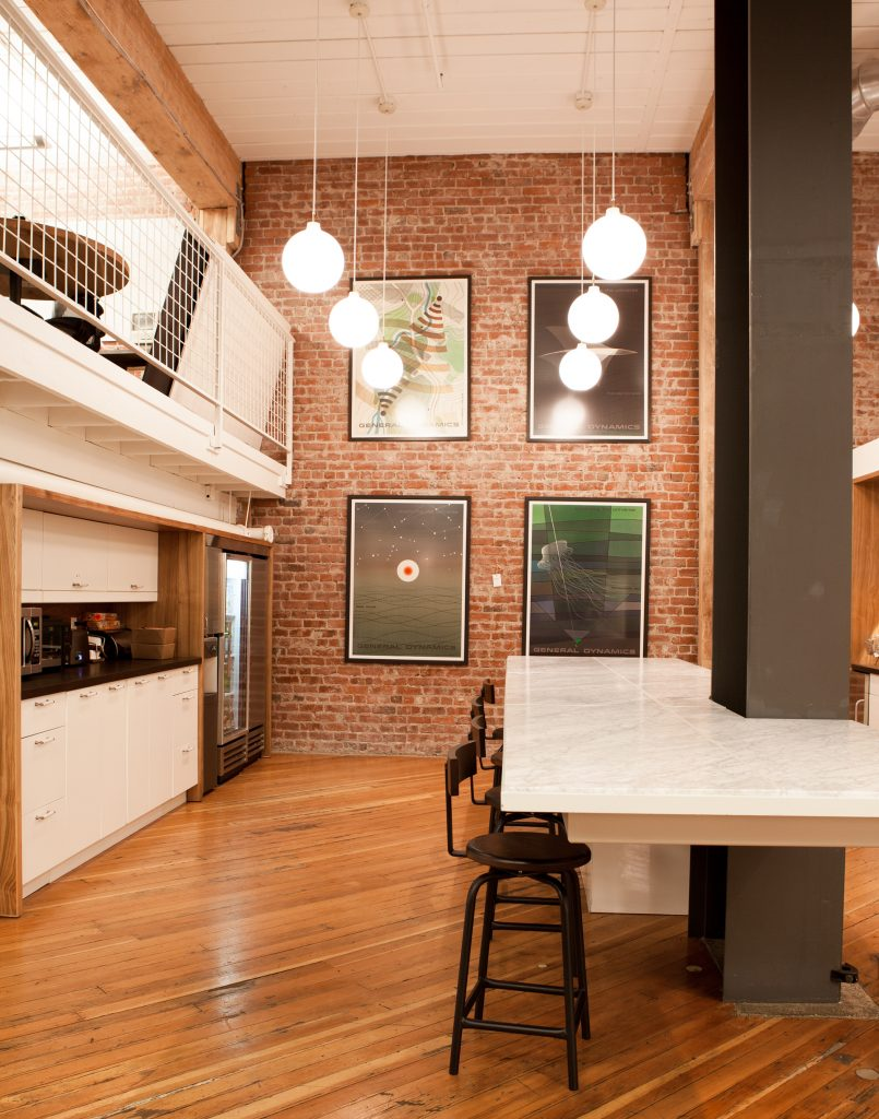 table attached to a black support beam // Method Office by Sky Lanigan Studios for Medium Plenty