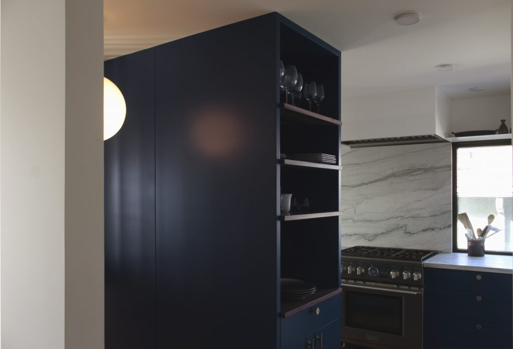 kitchen cabinets recede into the stairway // Cambridge by Sky Lanigan Studios