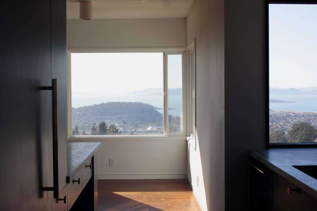 panoramic view of the bay from kitchen // Cambridge by Sky Lanigan Studios